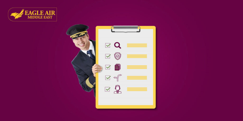 A pilot smiling as he peeks from behind a checklist.