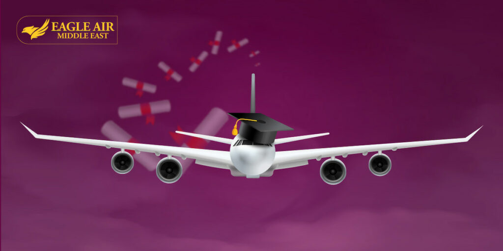 A white airplane with a graduation cap on its head.