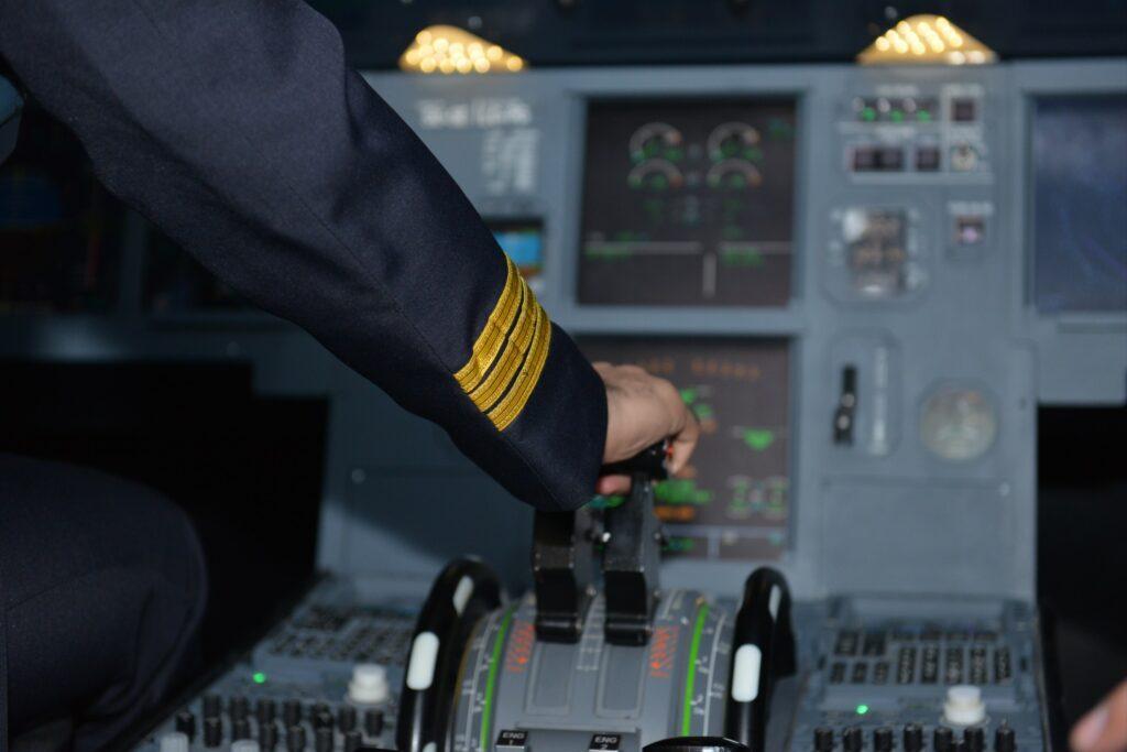 A Hand Using The Simulator Of Plane